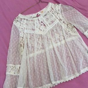 See through blouse with intricate lace designs